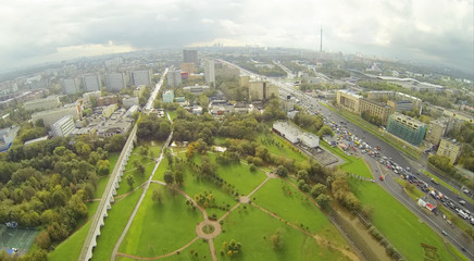 Road, aqueduct and park in city at cloudy day