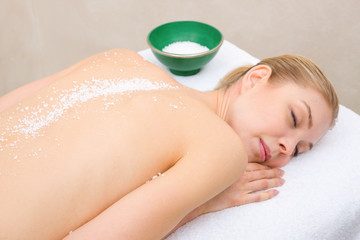 Woman resting with salt crystals back