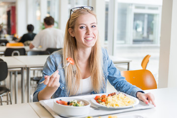 young student girl eating