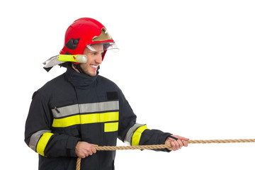 Firefighter pulling a rope