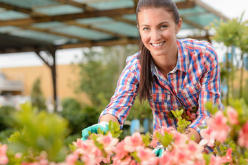 Smiling florist working in garden center