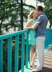 Sweet young couple kissing in the city summer