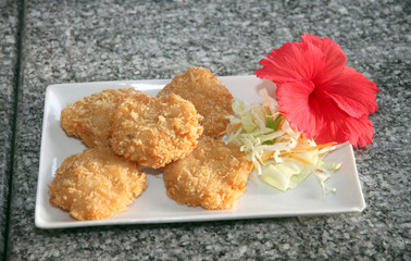 Fried shrimp of foods cake in white dish.