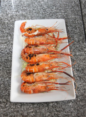 grilled of shrimp on white dish.