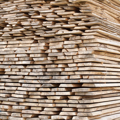 Stack of wood planks for construction buildings