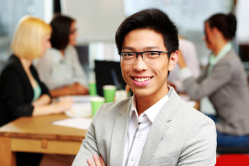 Portrait of smiling asian businessman sitting