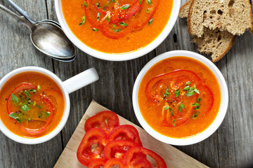 Roasted red peper soup in white bowl