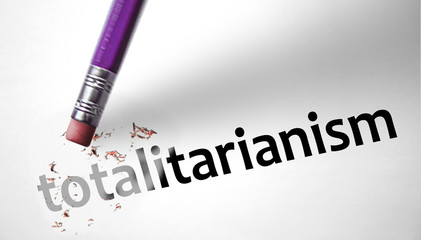 Eraser deleting the word Totalitarianism