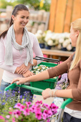 Two women shopping in garden center talking