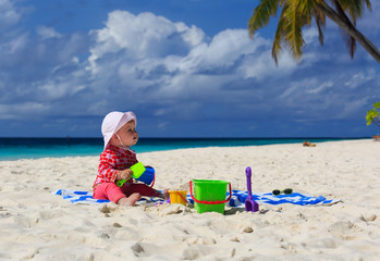 little girl playing on sand beach