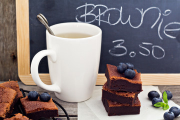 Stacked brownies with a cup of tea