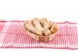 Sliced baguette on wicker basket.