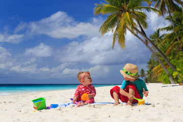 brother and sister playing on tropical beach