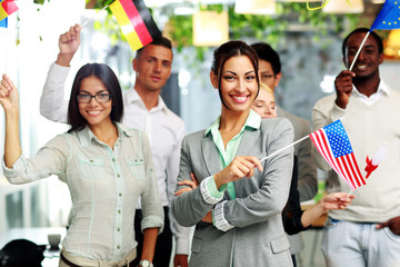 Patriotic businesswoman standing with USA flag