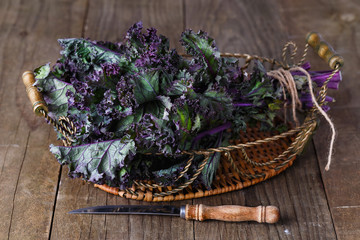 Bunch of kale on a rustic wooden background