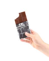 Hand holding foiled dark chocolate bars.