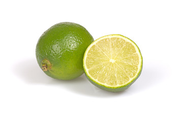 Whole citrus lime and half on the white background.