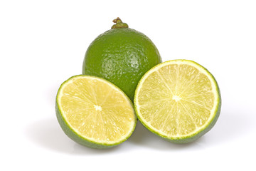 Whole and cut in half citrus lime.