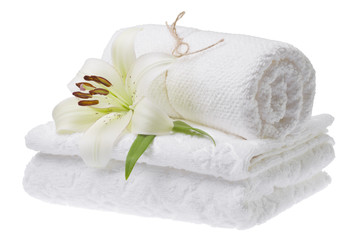 Stack of white towels with lily, isolated
