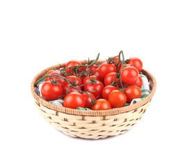 Wicker basket full of tomatoes.