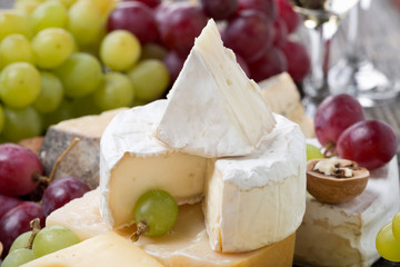 Camembert, different cheeses and grapes