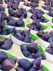 Ripe fig in boxes on a market counter