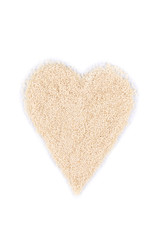 Heart shape from sesame seeds.