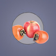 Two ripe persimmons and apple