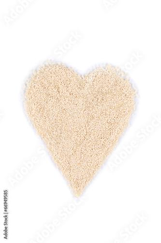 Heart shape from sesame seeds.