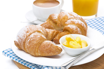 croissants with butter, espresso and orange juice