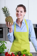 Lady of the house shows pineapple