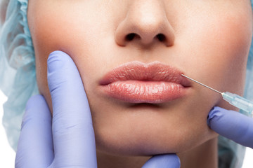 Cosmetic botox injection to the pretty woman face