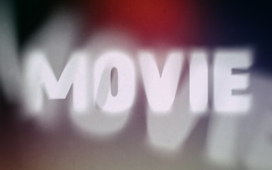 Movie word on vintage blurred background
