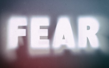 Fear word on vintage blurred background