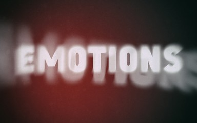 Emotions word on vintage blurred background