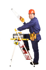Worker on ladder with saw.