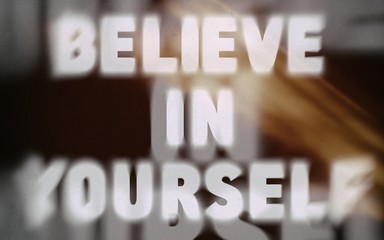 Believe in yourself word on blurred background