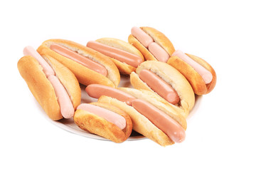 Bunch of hotdogs on plate.