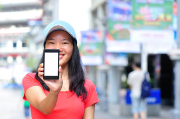woman hands hold blank smart phone  in modern city