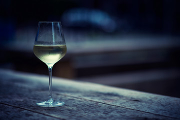 color image of chilled white wine in a glass , with copy space