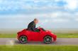 senior man driving a toy racing car