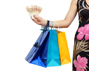 woman shows money savings with al lot of shopping bags
