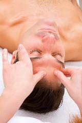 Man the spa center having head massage
