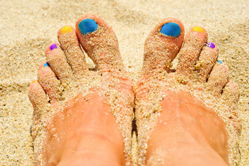 Colorful nails in the sand