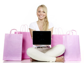 Blond woman shows tablet with copyspace
