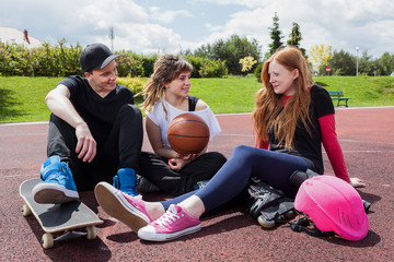 Baskatball players sitting on court