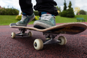Young person rides on skateboard