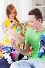 Girl and boy choosing clothes