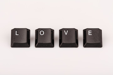 text love formed with computer keyboard keys on white background