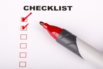 Checklist on white with marker